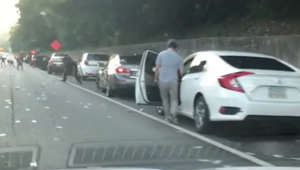 Drivers stop to gather cash raining down on Atlanta highway