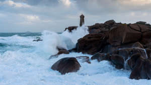 "This image was taken in Ploumanach near Perros-Guirrec with ""Men Ruz"" lighthouse during the storm Martin when waves of 8m camed on the coast.This the cote de Granite Rose with the house of ""douaniers"""
