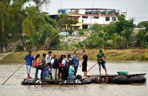 "Guatemalan migrants use a makeshift raft to illegaly cross the Suchiate river from Tecun Uman in Guatemala to Ciudad Hidalgo in Chiapas State, Mexico, on July 22, 2019. - The illegal crossing of Hondurans, Salvadoreans and Guatemalan to Mexico increased significantly since October but migratory controls have postponed the ""American dream"" of migrant families. Mexican President Andres Manuel Lopez Obrador agreed last month to crack down on undocumented migration, deploying tens of thousands of National Guardsmen to tighten its borders after US President Donald Trump threatened to impose tariffs. (Photo by ALFREDO ESTRELLA / AFP)        (Photo credit should read ALFREDO ESTRELLA/AFP/Getty Images)"