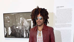 "23 May 2019, Hessen, Wetzlar: The musician, actor and photographer Lenny Kravitz stands in front of one of his photos in the Leica Gallery. Kravitz came to Mittelhessen to present his exhibition ""Drifter"". Photo: Carolin Eckenfels/dpa (Photo by Carolin Eckenfels/picture alliance via Getty Images)"