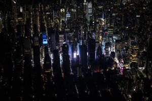 Pictures A large section of Manhattan's Upper West Side and Midtown neighborhoods are seen in darkness from above during a major power outage on July 13, in New York City.