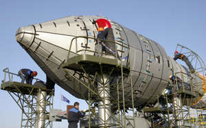 Workmen prepare the Galilieo (GIOVE-B) satellite of the European Space Agency (ESA) on its launch pad at Kazakhstan's Baikonur cosmodrome on April 23, 2008. The Galileo satellite navigation project will be launched from Kazakhstan on April 27.        AFP PHOTO / STR (Photo credit should read STR/AFP/Getty Images)