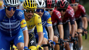 Cycling - Tour de France - The 170.5-km Stage 9 from Saint-Etienne to Brioude - July 14, 2019 - Deceuninck-Quick Step rider Julian Alaphilippe of France, wearing the overall leader's yellow jersey, in the peloton. REUTERS/Christian Hartmann