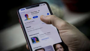 "This illustration picture shows FaceApp application displayed on the screen of a smartphone. - The popular app is in the in the eye of a political storm in the United States, with one senator urging an FBI investigation into its ""national security and privacy risks"".  (Photo illustration by Manuel Romano/NurPhoto via Getty Images)"