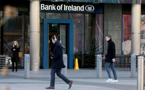 Pedestrians walk bast a brach of the Bank of Ireland near the Grand Canal Dock, in Dublin on January 8, 2019. - British MPs on Wednesday begin five days of debate ahead of a historic delayed vote on Prime Minister Theresa May's Brexit deal, a day after giving her a stinging blow aimed at preventing the country from crashing out of the EU with no agreement. Ireland was opposed to Brexit and is fearful both of the impact on trade with biggest economic partner Britain and any destabilising influence on the 1998 Good Friday Agreement, which ended three decades of sectarian conflict. (Photo by Paul FAITH / AFP)        (Photo credit should read PAUL FAITH/AFP/Getty Images)