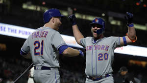 New York Mets' Pete Alonso, right, celebrates with Todd Frazier (21) after hitting a home run off San Francisco Giants' Williams Jerez in the 16th inning of a baseball game Thursday, July 18, 2019, in San Francisco. (AP Photo/Ben Margot)