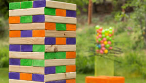 """Jenna"" Style outdoor block game in purple, orange an green."