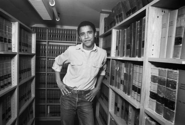 Slide 2 of 32: Barack Obama, graduate of Harvard Law School '91, is photographed on campus after was named head of the Harvard Law Review in 1990. (Photo by Joe Wrinn/Harvard University/Corbis via Getty Images)