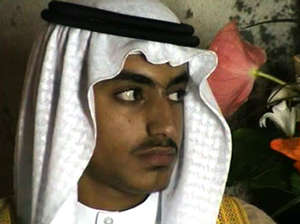 In this image from video released by the CIA, Hamza bin Laden is seen as an adult at his wedding. The never-before-seen video of Osama bin Laden's son and potential successor was released Nov. 1, 2017, by the CIA in a trove of material recovered during the May 2011 raid that killed the al-Qaida leader at his compound in Pakistan. The one hourlong video shows Hamza bin Laden, sporting a trimmed mustache but no beard, at his wedding. He is sitting on a carpet with other men. (CIA via AP)