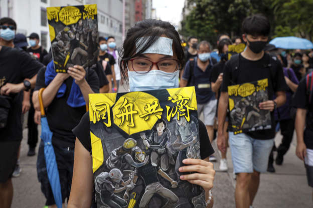 "Slide 26 of 71: Protesters hold posters depicting protesters, medical worker and people help an injured protester bearing the words ""Together"" as they take part in the anti-extradition bill protest march at Shum Shui in Hong Kong, Sunday, Aug. 11, 2019. Separate protests were being held in two parts of Hong Kong on Sunday in a continuing series of demonstrations that have generally started peacefully but often ended in violent clashes with police. (AP Photo/Kin Cheung)"