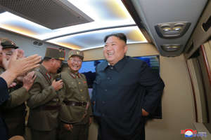 "FILE - In this Tuesday, Aug. 6, 2019, file photo provided by the North Korean government, North Korean leader Kim Jong Un, right, visits an airfield in the western area of North Korea to watch its weapons demonstrations. North Korea on Friday, Aug. 9, 2019 said that its rubber-stamp parliament will hold its second meeting of the year on Aug. 29. It follows weeks of intensified North Korean weapons tests and belligerent statements over U.S.-South Korea military exercises and the slow pace of nuclear negotiations with the United States. Independent journalists were not given access to cover the event depicted in this image distributed by the North Korean government. The content of this image is as provided and cannot be independently verified. Korean language watermark on image as provided by source reads: ""KCNA"" which is the abbreviation for Korean Central News Agency. (Korean Central News Agency/Korea News Service via AP, File)"