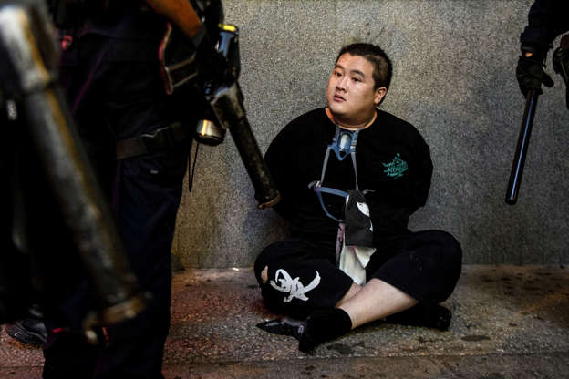 Slide 20 of 71: Police arrest a man during protests in Tsim Sha Tsui in Hong Kong on August 11, 2019, in the latest opposition to a planned extradition law that was quickly evolved into a wider movement for democratic reforms. - Thousands of pro-democracy protesters hit the streets of Hong Kong for a tenth weekend in-a-row on August 11, again defying police who fired volleys of tear gas at several locations. (Photo by ANTHONY WALLACE / AFP)        (Photo credit should read ANTHONY WALLACE/AFP/Getty Images)