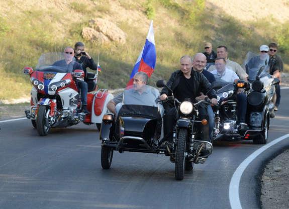 Slide 2 of 55: Russian President Vladimir Putin rides a bike before the Babylon's Shadow bike show in Sevastopol, Crimea on August 10, 2019. (Photo by Alexei Druzhinin / Sputnik / AFP) (Photo credit should read ALEXEI DRUZHININ/AFP/Getty Images)