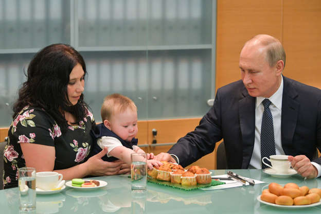 Slide 3 of 55: YEKATERINBURG, RUSSIA - JULY 9, 2019: Russia's President Vladimir Putin meets with the Syropyatov family who received the Orders of Parental Glory, an award given to parents of large families, in May 2019. The Syropyatov family has nine children. Alexei Druzhinin/Russian Presidential Press and Information Office/TASS (Photo by Alexei Druzhinin\TASS via Getty Images)
