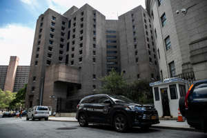 A medical examiner vehicle is seen on Aug. 10, 2019, in front of the Metropolitan Correctional Center jail where financier Jeffrey Epstein was found dead.