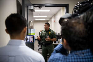 MCALLEN, TEXAS - AUGUST 12: Acting Deputy Patrol Agent in Charge Oscar Escamilla speaks to members of the media at the US Border Patrol Central Processing Center in McAllen, Texas on August 12, 2019. Border Patrol officials said that 1,267 people were being held and processed in the facility at the time of the tour.  (Photo by Carolyn Van Houten/The Washington Post via Getty Images)