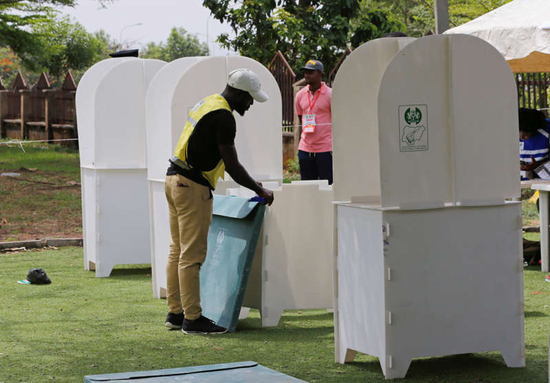 Independent National Electoral Commission (INEC) worker packs up voting booths after the polls closed during the Nigeria's governorship and state assembly election at the Gwarinpa ward in Abuja, Nigeria March 9, 2019. REUTERS/Afolabi Sotunde