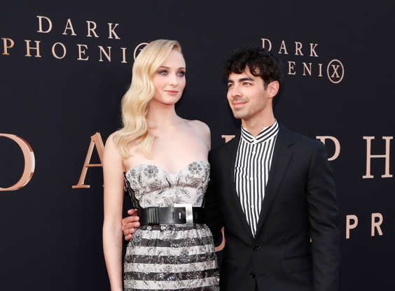 "Actor Sophie Turner poses with her husband Joe Jonas at the premiere for the film ""Dark Phoenix"" in Los Angeles, California, U.S., June 4, 2019."