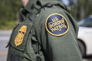 U.S. Border Patrol officer at a highway checkpoint.