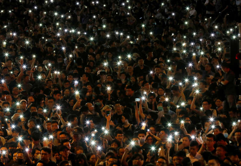 Attendees hold up their lit mobile phones during a rally by civil servants to support the anti-extradition bill protest in Hong Kong, China August 2, 2019. REUTERS/Kim Kyung-Hoon