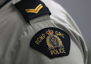 """A Royal Canadian Mounted Police (RCMP) crest is seen on a member's uniform, at the RCMP """"D"""" Division Headquarters in Winnipeg, Manitoba Canada, July 24, 2019."""