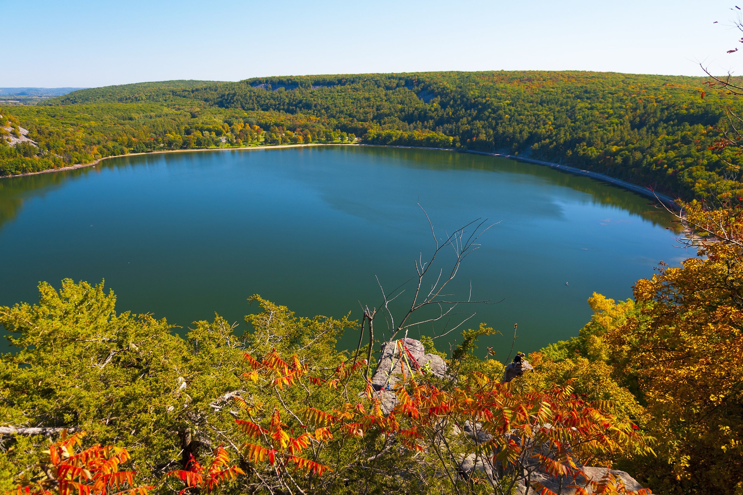 Slide 51 of 52:  Where: Devil's Lake State Park Distance: 7.5-mile loop Must see: Hike to the top of a 500-foot bluff to get a panoramic view of Devil's Lake, and view other landmarks such as Devil's Doorway and Balanced Rock.