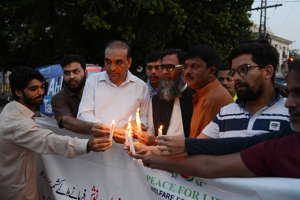 LAHORE, PUNJAB, PAKISTAN - 2019/08/18: Pakistani members of Peace for Life Welfare Foundation light the candles in remembrance of martyred Pakistan Army personnel during unprovoked firing of Indian Army on the Line of Control between Pakistan and Indian Kashmiris (LOC)  in front of Punjab Assembly at Faisal Chowk in provincial capital Lahore. Two elderly civilians were killed in unprovoked Indian attack across the Line of Control (LoC) on Sunday. According to a statement issued by the Inter-Services Public Relations (ISPR).