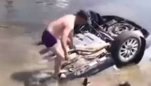 Heroic men rescue people trapped in car that landed upside down in river