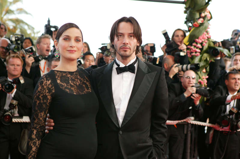 "FRANCE - MAY 15:  56th Cannes Film Festival: Stairs of ""The Matrix reloaded"" in Cannes, France on May 15, 2003 - Carrie-Anne Moss and Keanu Reeves.  (Photo by Pool CATARINA/LEPETIT/Gamma-Rapho via Getty Images)"