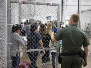 A view of inside U.S. Customs and Border Protection (CBP) detention facility shows detainees inside fenced areas at Rio Grande Valley Centralized Processing Center in Rio Grande City, Texas, U.S., June 17, 2018.