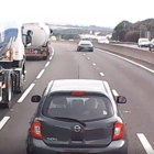 Dashcam catches near miss as UK car pulls out in front of speeding truck