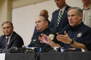 Texas Gov. Greg Abbott gestures during a news conference concerning Saturday's shooting Sunday, Sept. 1, 2019, in Odessa, Texas. From left are Christopher Combs, FBI Special Agent in Charge, San Antonio, Odessa Police Chief Michael Gerke and Abbott.