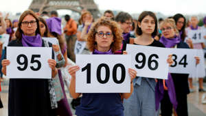 "People gather on the Trocadero square in front of the Eiffel tower in Paris during a demonstration called by the ""Nous Toutes"" feminist organisation to denounce the 100th feminicide of the year, on September 1, 2019. - For the year 2018, the Ministry of the Interior had identified 121 feminicides. (Photo by Zakaria ABDELKAFI / AFP)        (Photo credit should read ZAKARIA ABDELKAFI/AFP/Getty Images)"