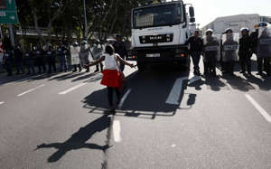 Students clash with police as they try to storm the Cape Town International Convention Centre where the World Economic Forum is taking place during a march demanding justice and protection amid violent attacks on women and children on September 04, 2019 in Cape Town, South Africa.