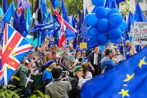 LONDON, UNITED KINGDOM - 2019/09/03: Anti-Brexit protesters with flags playing music while demonstrating in central London on the day MPs return back to Parliament after the summer recess. On Monday 2 Sept 2019 British Prime Minister Boris Johnson warned Conservative MPs not to vote against the government in the next night's Bill that would block a no deal Brexit. Several MPs vowed to vote with the opposition regardless of the personal consequences. (Photo by Steve Taylor/SOPA Images/LightRocket via Getty Images)