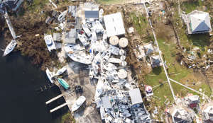 An aerial view of view of damaged boats in Hurricane Dorian devastated Elbow Key Island on September 7, 2019 in Elbow Key Island, Bahamas.  The official death toll has risen to 43 and according to officials is likely to increase even more.