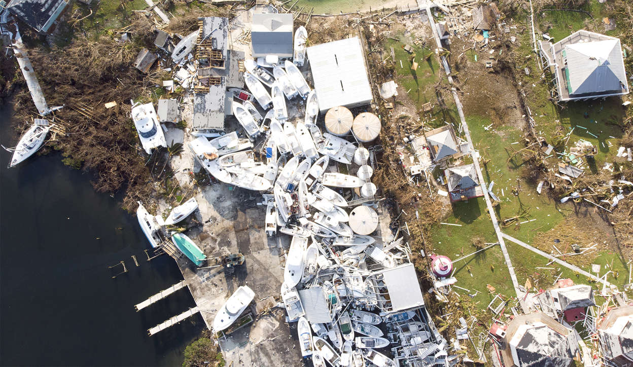 Slide 1 of 75: An aerial view of view of damaged boats in Hurricane Dorian devastated Elbow Key Island on September 7, 2019 in Elbow Key Island, Bahamas.  The official death toll has risen to 43 and according to officials is likely to increase even more.