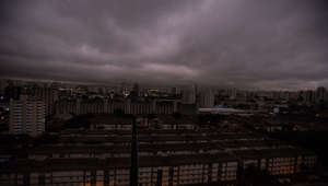 19 August 2019, Brazil, Sao Paulo: On the photo from Monday, August 19, you can see the darkened sky in Sao Paulo. Residents of this metropolis of millions recently reported black rain. Studies by two universities confirmed that the rainwater contains fire residues, as reported by the news portal G1. Photo: Andre Lucas/dpa (Photo by Andre Lucas/picture alliance via Getty Images)