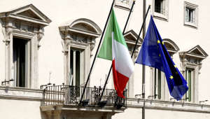 Rome, Italy - September 23, 2011: Flags at the Palazzo Chigi at the Piazza Colonna in Rome - Residence of the Italian Prime Minister.