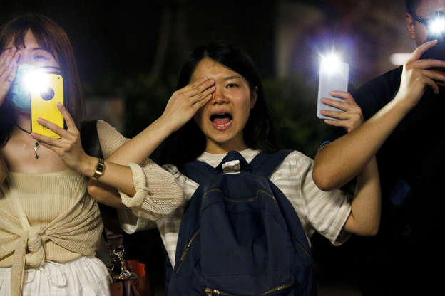 Slide 1 of 55: Protesters light up their smartphones and cover their right eye as they form a human chain during a rally to call for political reforms along Tsim Sha Tsui and Hung Hom Promenade in Hong Kong, on August 23.