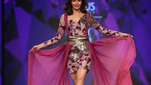 NEW DELHI, INDIA  MARCH 14: Bollywood actor Karishma Tanna walks the ramp for designer duo Gauri & Kunal at Lotus Make-Up India Fashion Week Autumn Winter' 2019, at Jawahar Lal Nehru Stadium, on March 14, 2019 in New Delhi, India. (Photo by Raajessh Kashyap/Hindustan Times via Getty Images)