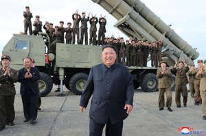"This Saturday, Aug. 24, 2019, photo provided Sunday, Aug. 25, by the North Korean government, shows North Korean leader Kim Jong Un, center, claps hands as Kim watches the test firing of an unspecified missile at an undisclosed location in North Korea. North Korea fired two suspected short-range ballistic missiles off its east coast on Saturday in the seventh weapons launch in a month, South Korea's military said, a day after it vowed to remain America's biggest threat in protest of U.S.-led sanctions on the country. The content of this image is as provided and cannot be independently verified. Korean language watermark on image as provided by source reads: ""KCNA"" which is the abbreviation for Korean Central News Agency."