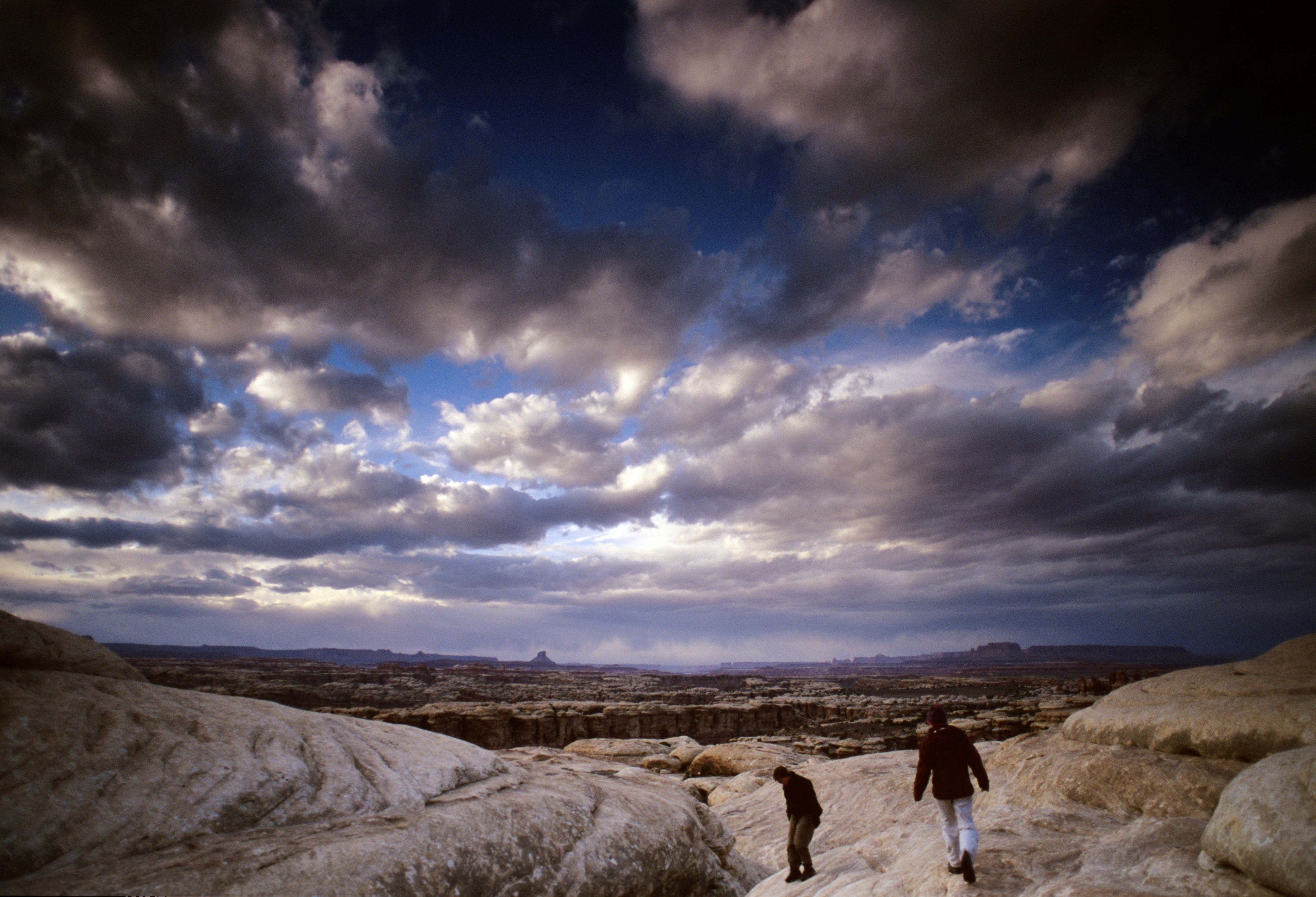Backpacking Hikers travel through the Needles district of Canyonlands National Park in southern Utah. March 14, 2004 ��Tim Tadder/NewSport MODEL RELEASED (Photo by Tim Tadder/Corbis via Getty Images)