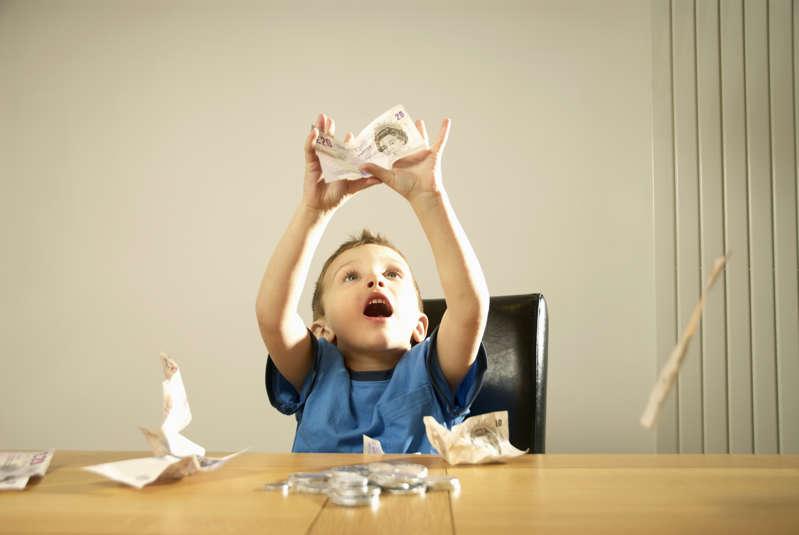 Boy catching money