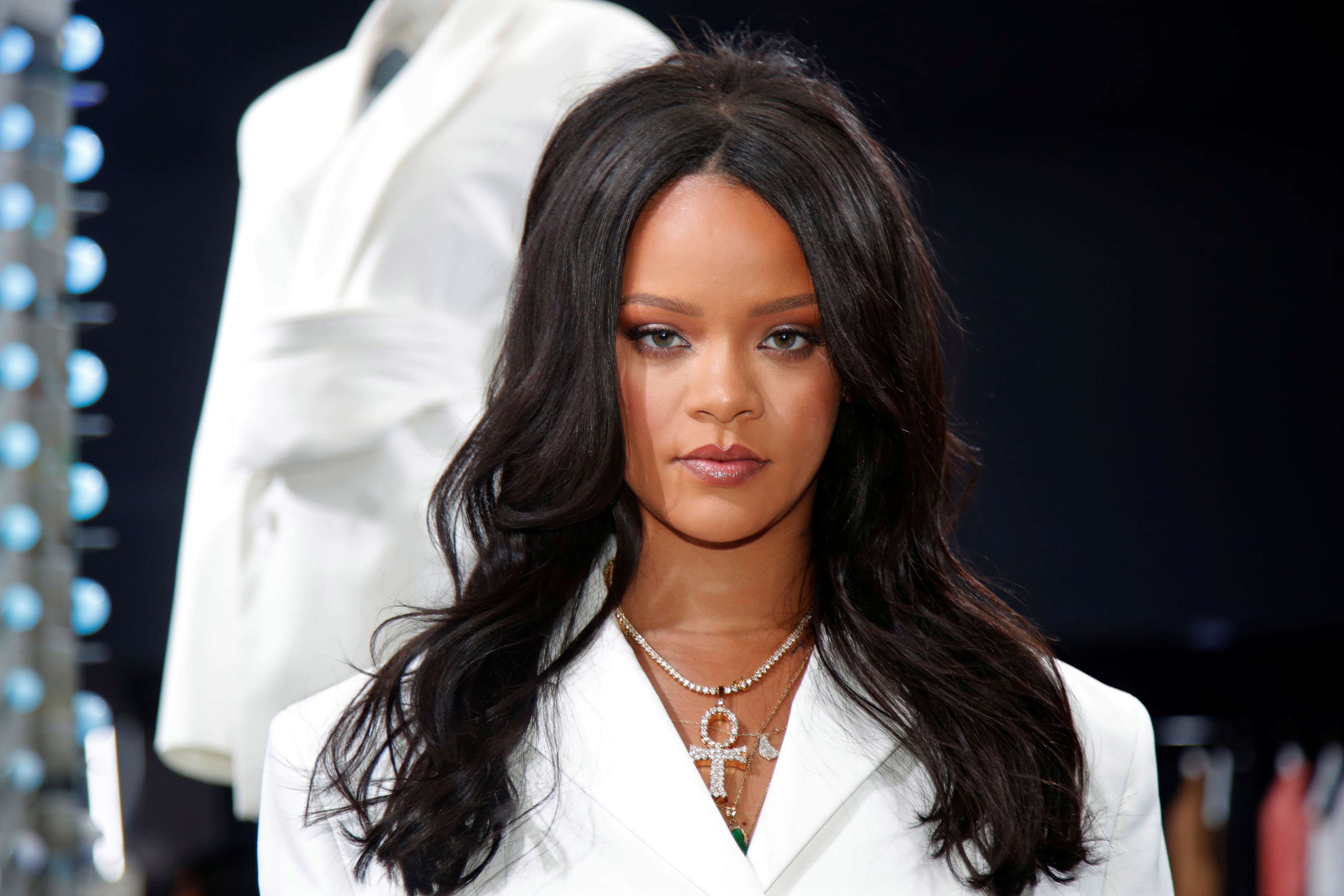 Slide 9 of 11: Pop superstar Rihanna poses in a pop-up store to present her first collection with LVMH for the new label, Fenty, which includes ready-to-wear and accessories, such as shoes, sunglasses and jewellery, Paris, France May 22, 2019. Picture taken May 22, 2019.   REUTERS/Charles Platiau