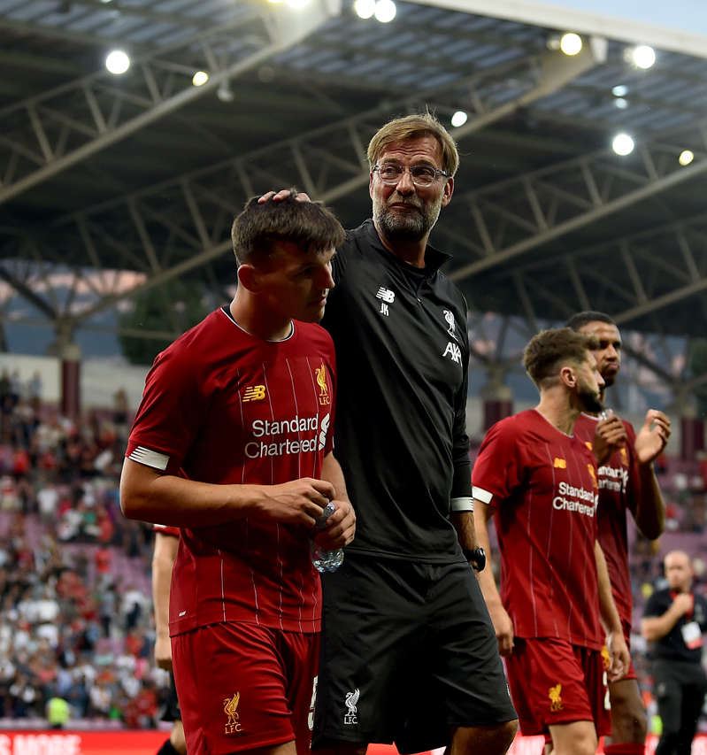 GENEVA, SWITZERLAND - JULY 31: (THE SUN OUT, THE SUN ON SUNDAY OUT) Bobby Duncan and Jurgen Klopp mamnager of Liverpool at the end of the Pre-Season Friendly match between Liverpool and Olympique Lyonnais at Stade de Geneve on July 31, 2019 in Geneva, Switzerland. (Photo by Andrew Powell/Liverpool FC via Getty Images)