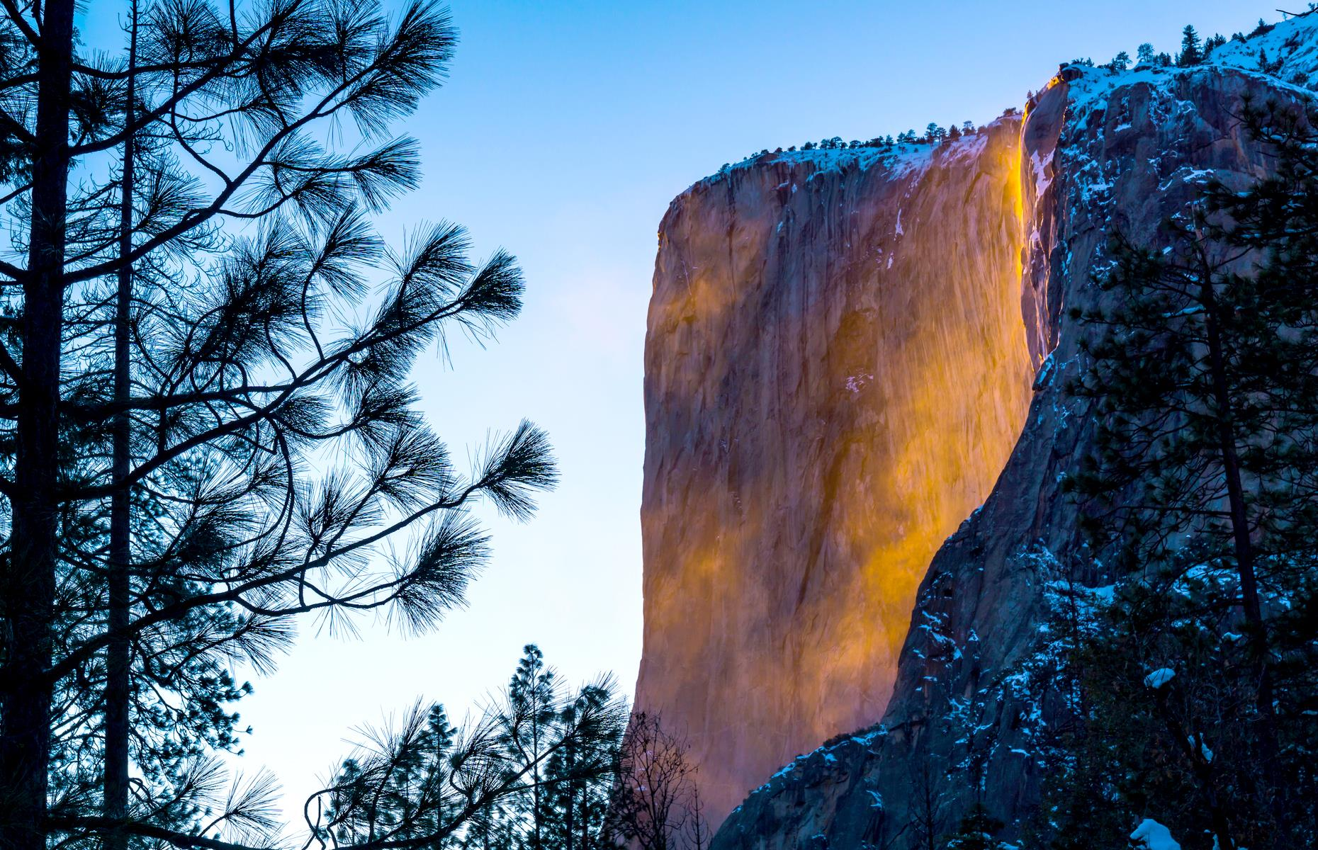Slide 8 of 61: For much of the year, Horsetail Fall, which cascades over the eastern side of El Capitan in Yosemite National Park, looks like any other waterfall. But, come February, something magical happens. On clear nights, when the sun is setting and the light strikes right, the waterfall takes on a burning orange glow and spills over the mountain face like lava. Various hiking trails wind towards the falls, each one at least a mile in length.