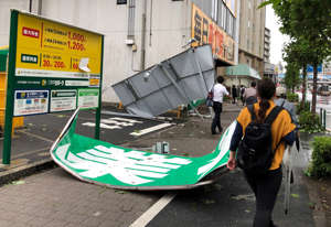 Collapsed steel advertising boards caused by Typhoon Faxai are seen at Edogawa ward in Tokyo, Japan September 9, 2019.  REUTERS/Kiyoshi Takenaka