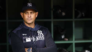 BOSTON, MA - SEPTEMBER 06:  Manager Aaron Boone of the New York Yankees looks on from the dugout before a game against the Boston Red Sox at Fenway Park on September 6, 2019 in Boston, Massachusetts.  (Photo by Adam Glanzman/Getty Images)