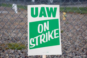 The United Auto Workers (UAW) picket sign is visible outside the General Motors Powertrain Flint Engine plant during the UAW national strike in Flint, Michigan, USA, September 16, 2019.